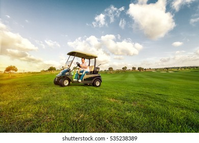 golf man in cart enjoy