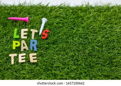Golf par tee with golf ball and tee on green grass