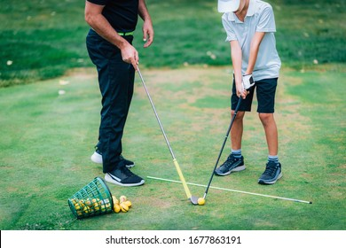 Golf – Personal Training. Golf Instructor Teaching Young Boy How to Play Golf.