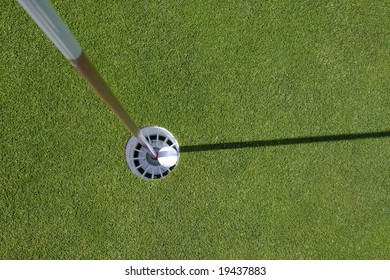 golf pin with gol ball