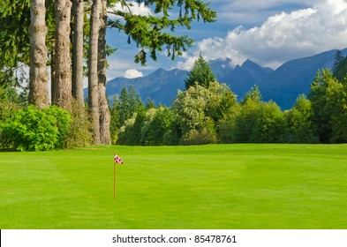Golf place with gorgeous green and fantastic mountain and blue sky view