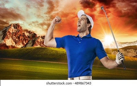 Golf Player in a blue shirt celebrating, on a golf course.