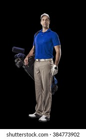 Golf Player in a blue shirt, standing with a bag of golf clubs on his back, on a Black Background.