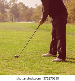 Golf player on golf course.