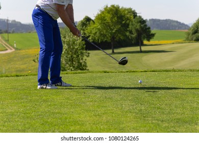golf player on course of beautiful green grass and sunshine in springtime south germany countryside