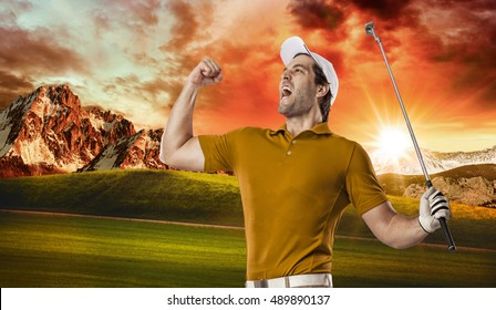 Golf Player in a orange shirt celebrating, on a golf course.