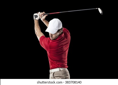 Golf Player in a red shirt taking a swing, on a black Background.