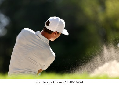 golf player in sand trap