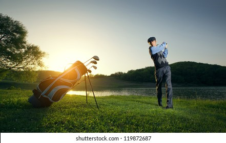 Golf player strikes the ball strongly