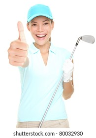 Golf player success woman smiling giving thumbs up hand sign holding golf club isolated on white background. Young mixed race Asian Caucasian female golf player.