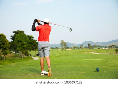 Golf player swing in golf course at beautiful golf course