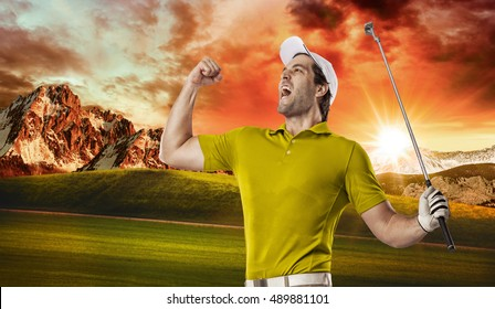 Golf Player in a yellow shirt celebrating, on a golf course.
