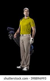 Golf Player in a yellow shirt, standing with a bag of golf clubs on his back, on a Black Background.