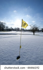 Golf pole in the snow, France, Mionnay