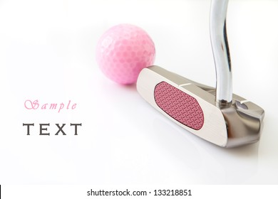 Golf putt and pink ball in white background