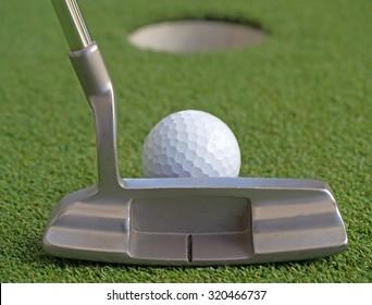 Golf putter set up to the ball
