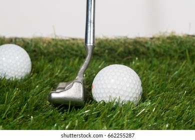 Golf putting on green and white background.