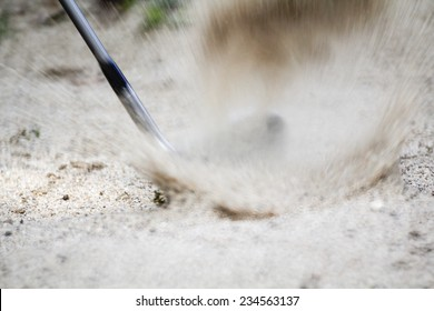 Golf sand wedge hitting in trap