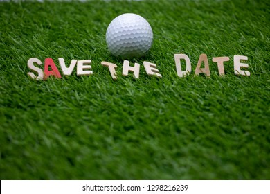Golf  save the date with golf ball on green grass