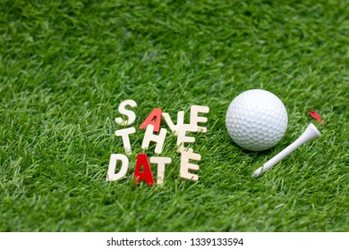 Golf save the date with golf ball and tee on green grass