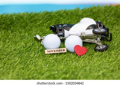 Golf save the date in September with golf ball and golf bag on green grass