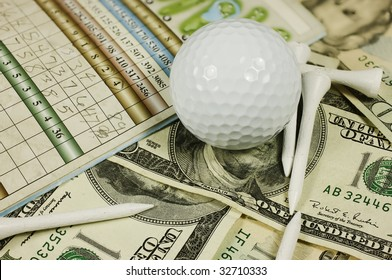 Golf scorecard with ball and tees over a bed of cash.