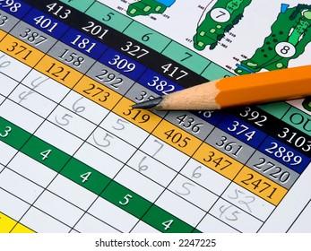 a golf scorecard and pencil