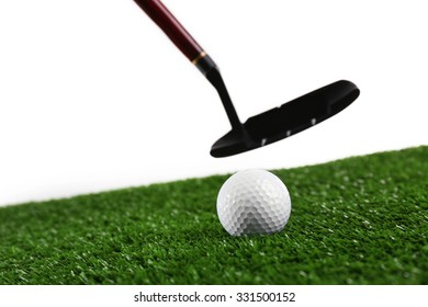 Golf set on grass isolated on white