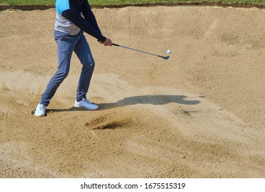 golf shot from sand bunker golfer hitting ball from sand trap