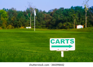 golf signs on green grass at morning