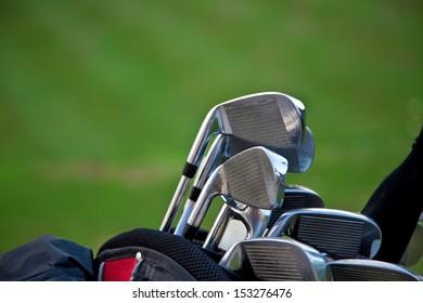 Golf sticks on grass/golf sticks horizontal composition