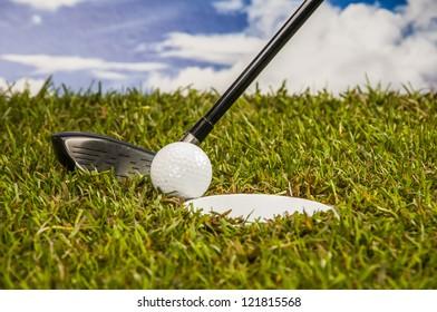 Golf stuff on sunny golf field