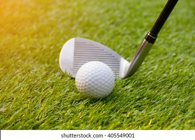 Golf swing shot on grass in summer