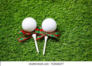 Golf with tee on Christmas holiday