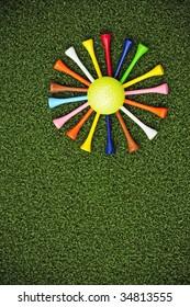 golf tees arranged around golf ball to form daisy