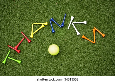 golf tees spelling out Thanks with golf ball