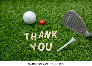 Golf Thank you sign with golf ball on green grass