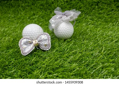 Golf wedding with bride and groom golf on green grass.