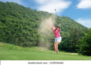 Golf women.  Cheerful happy asian smiling woman with playing golf in the golf club in the sunny  time, copy space. Lifestyle Concept