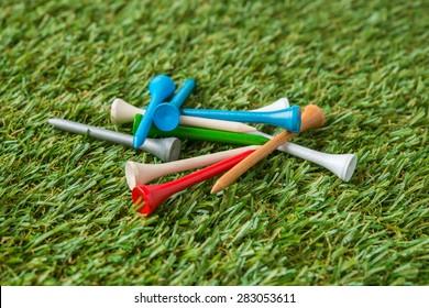 golf wood tee on grass