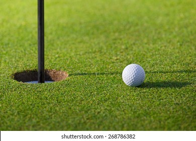 Golfball going to hole