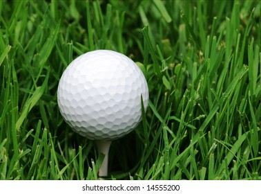 Golfball on tee in the grass
