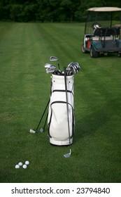 Golf-clubs with bag and golf-car. Focus on bag