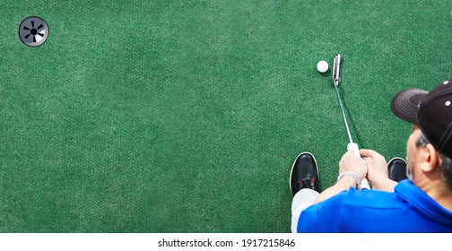 Golfer about to putt on green