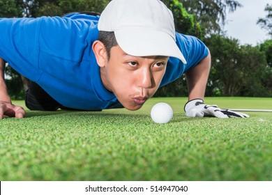 Golfer air blower golf ball to golf hole