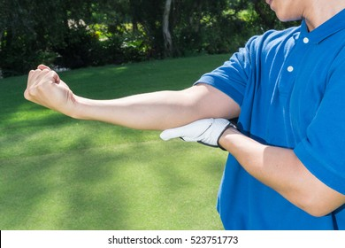 Golfer Arm and Elbow pain, muscle injury concept.