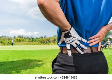 Golfer Back pain during a game, muscle injury concept.