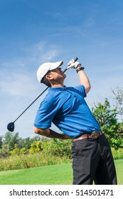 Golfer Back pain during swing golf, muscle injury concept.