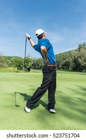 Golfer back pain during swing golf ball, muscle injury concept.