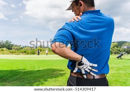 golfer back shoulder pain during game stock photo edit